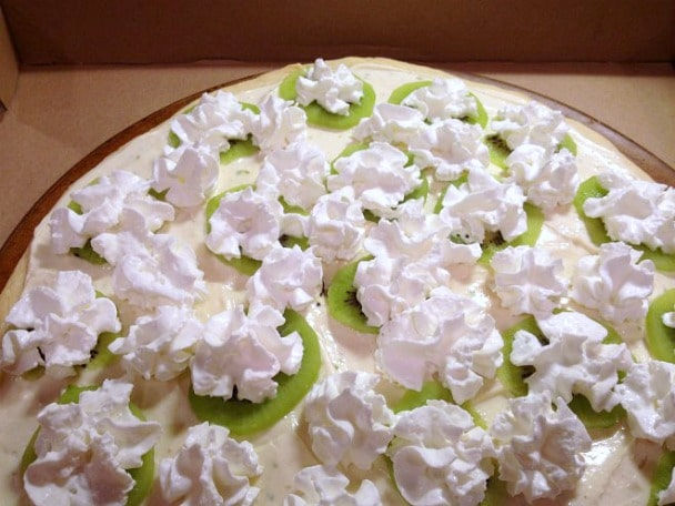 My Key Lime Pizza is the combination of key lime pie and a shortbread cookie crust. Baked and served with whipped cream and a tangy lime topping.
