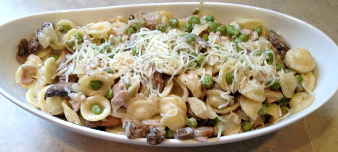 Orecchiette Pasta with Ham, Mushrooms and Peas can be served as either a main dish or a wonderful side for grilled pork chops or chicken. Simple and loaded with flavor!