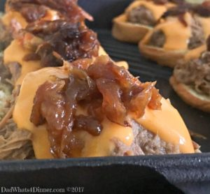 Beer Braised Shredded Beef Sliders are the best non-traditional slider you will ever have. Slow cooked beef, beer cheese, caramelized onions on a soft slider bun.
