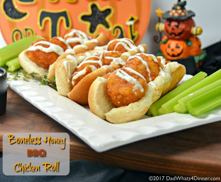 Three Boneless Honey BBQ Chicken Roll with Creamy Ranch Sauce on a plate with celery for a quick and simple trick or treat night snack you can make with your kids.